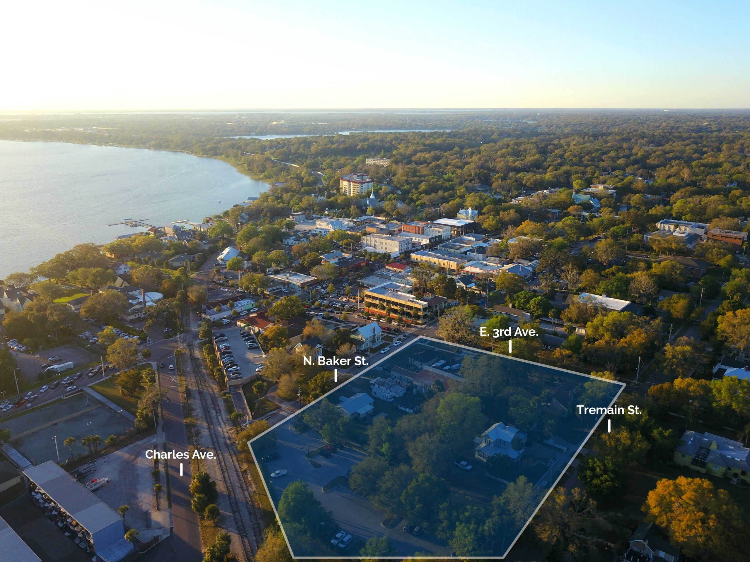 aerial image over mount dora with graphic overlay highlighting the gaslight district of downtown